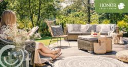 honor credit union has answers to your home equity questions; woman sitting on a chair on a patio reading a book in the sun