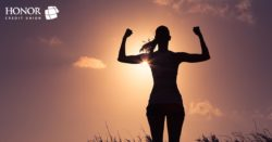 honor credit union can help you create a plan to save money; woman flexing her muscles in a sunset