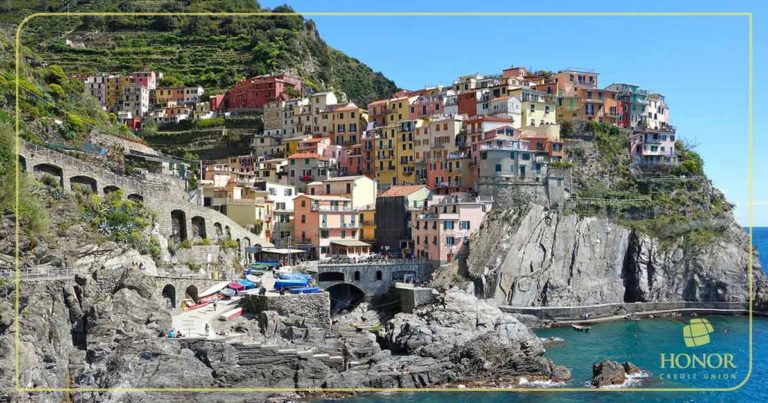 a few money saving tips can help a family of four afford a trip to italy; photo of italian shoreline