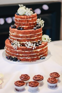 wedding cake with white frosting sitting on a table