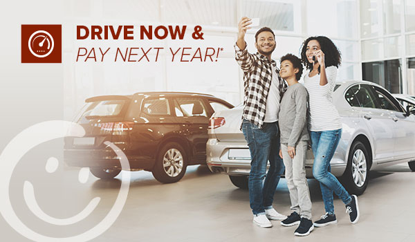 new auto loans no payments until 2020 at honor credit union; family taking a selfie at a car dealership