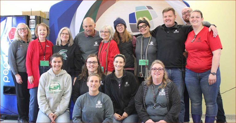 honor adoption day at berrien county animal control on november 16, 2019; photo of volunteers posing for a photo on adoption day