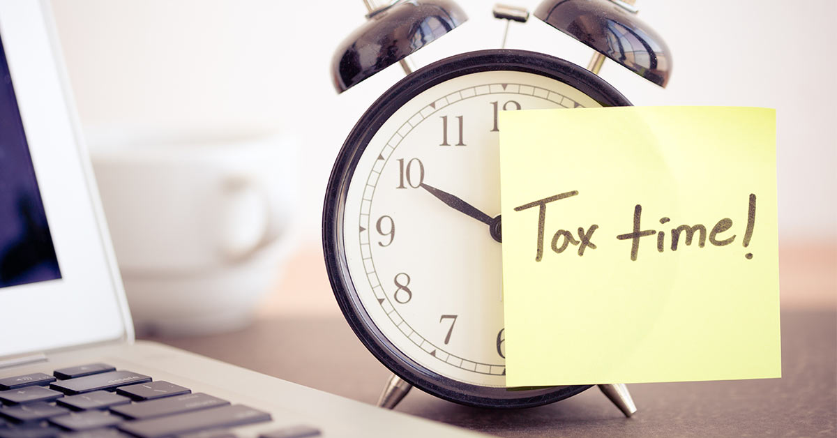 image of a sticky note on an alarm clock that reads tax time; honor credit union has tips to help make filing taxes easy