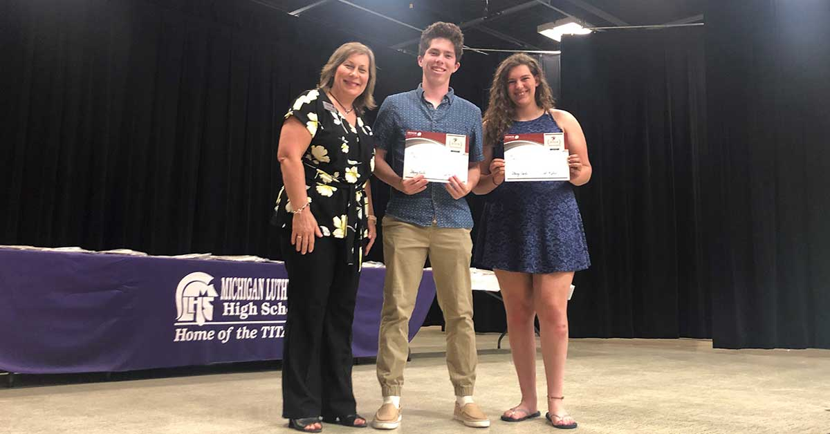 honor credit union will award 24 scholarships worth $1,00 each to graduating high school seniors; photo of 2019 winners being presented their scharships