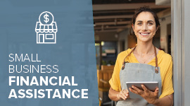 image of a business owner smiling while holding a tablet device with text that explains financial assistance is available for small business owners