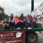 The kids love riding on the Honor float in the Apple Fest parade in Niles