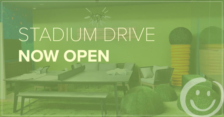 image of a lounge area with a green color overlay and white text that reads Stadium Drive now open