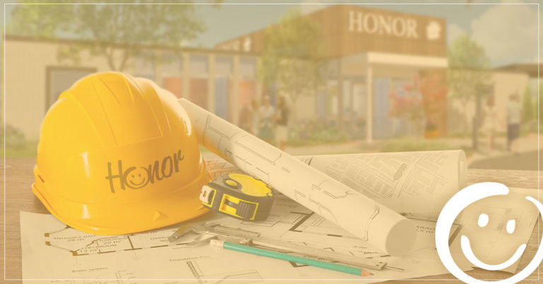 image of a construction hat resting on a table with a background rendering image of the new berrien springs member center