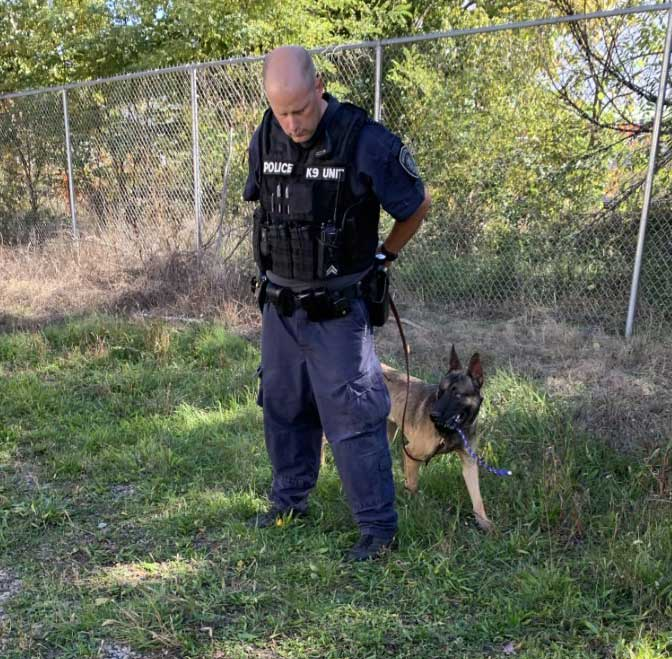 photo of battle creek police department patrol dog skube with handler corporal kevin farnham