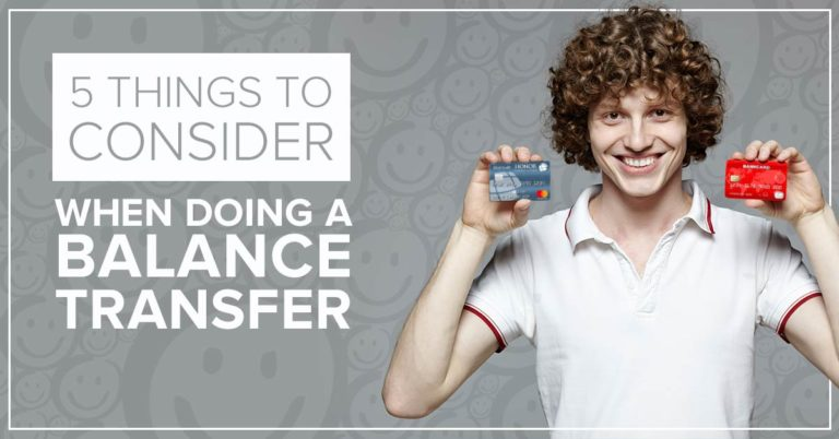 image of a man with curly brown hair smiling while holding up an honor credit union credit card in one hand and a bank credit card in the other hand with text on the image that reads 5 things to consider when doing a balance transfer