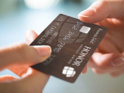 Handing a Business Debit card to member